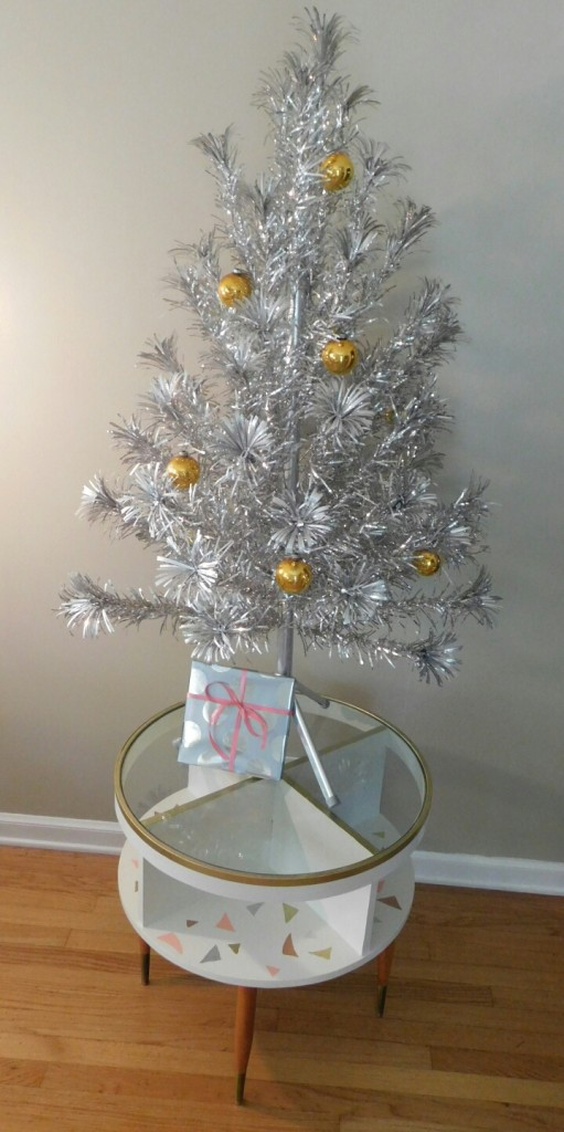 As I suspected and hoped--a lovely stand for the aluminum Christmas tree.