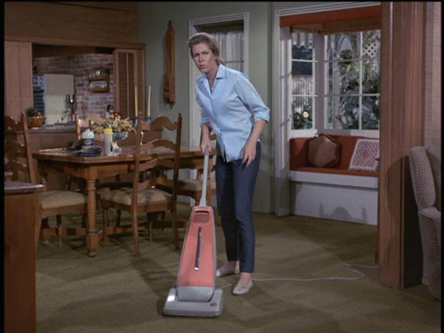 Would an old-fashioned witch vacuum? Heck no. Sam is as modern as they come.