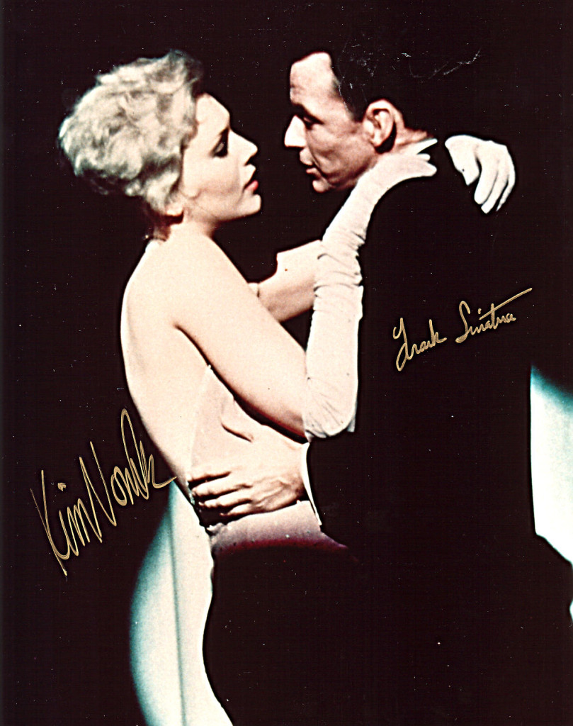 Frank with Kim Novak. That witch can stare!