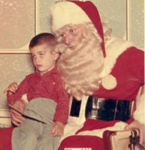 A three-year-old on Santa's lap in a Virginia Department store, circa 1961. The child appears to be a bit fearful as to his status regarding The Naughty and Nice List.