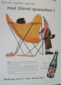 Seven-Up ad featuring the Butterfly chair. The sensitive lines (the chair's metal legs) resemble the atomic symbol.
