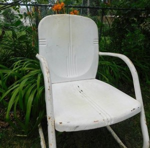 When I found the chair. Dull, flat white paint and bits of rust.